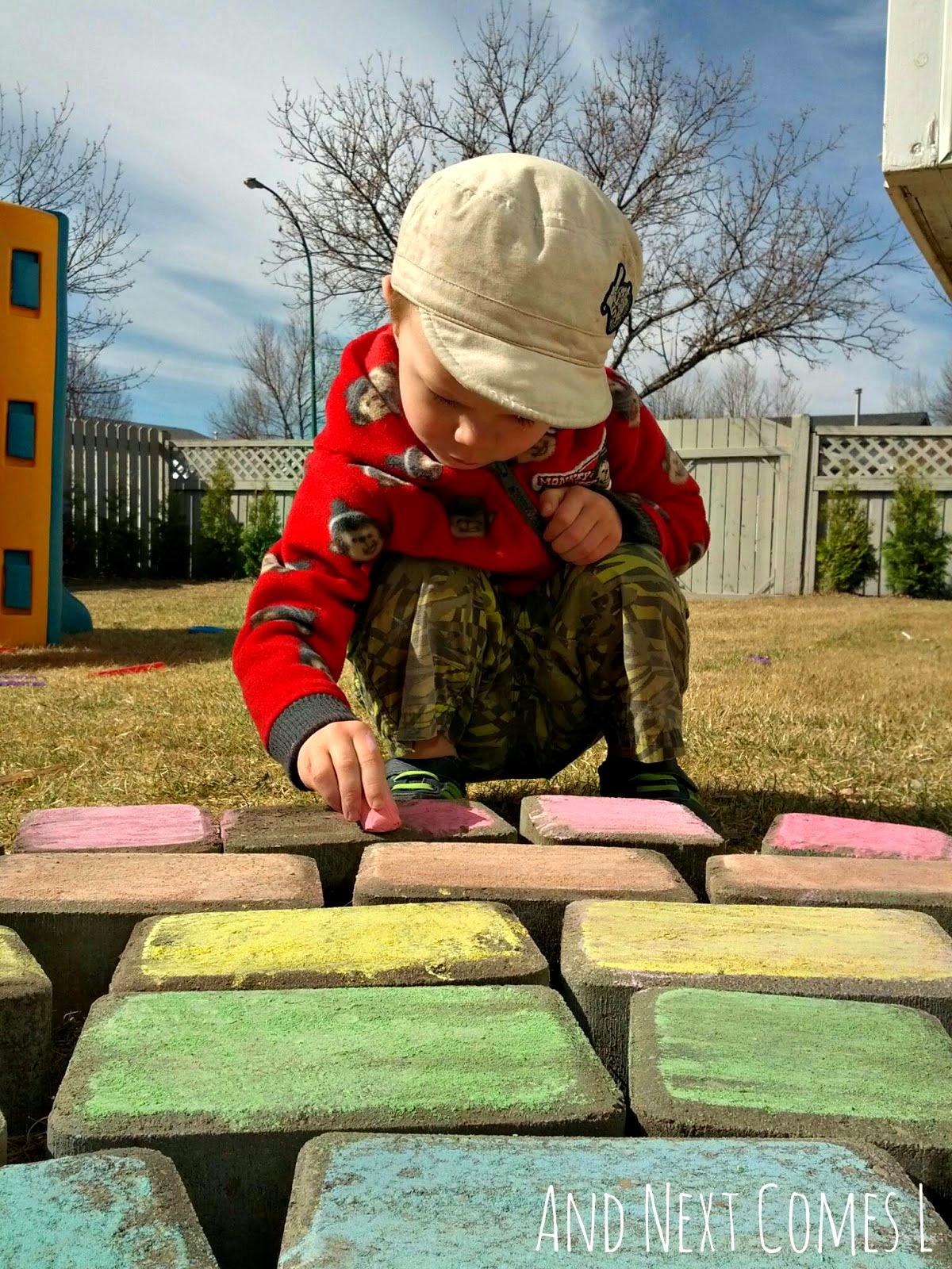 Coloring a giant chalk rainbow from And Next Comes L