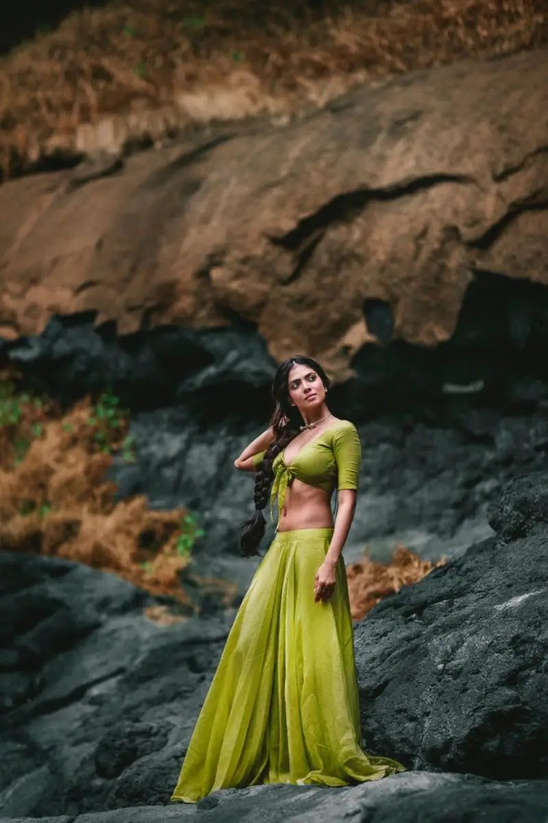 Actress Malavika Mohanan Latest Photos In Green Skirt And Knotted Blouse