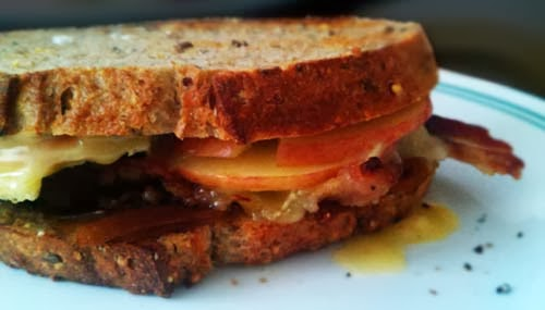 Tasty Bacon, Brie, Caramelized Onion, and Apple Sandwich