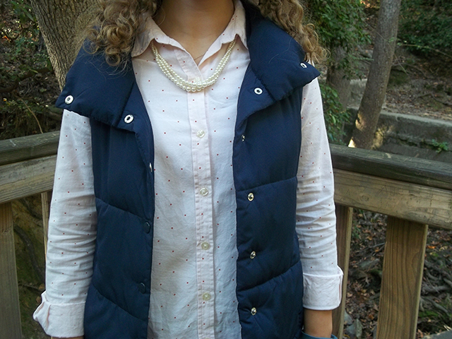 pale pink polka dot button down flare jeans navy puffer vest leopard flats pearl necklace outfit style link up grace and lace