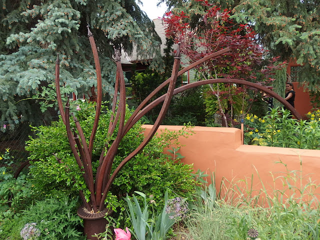 A bold garden sculpture and terracotta walls