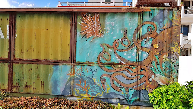 A painted cargo container in the middle of Puerto Morelos...