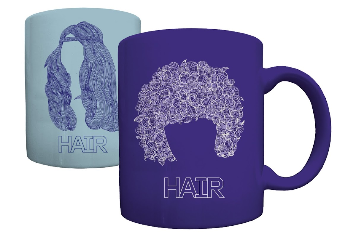 two of the Hair coffee mugs