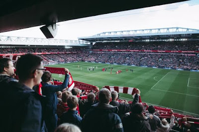 Crowd watching a Liverpool match