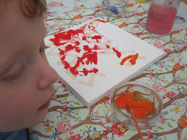 A canvas being painted by a child
