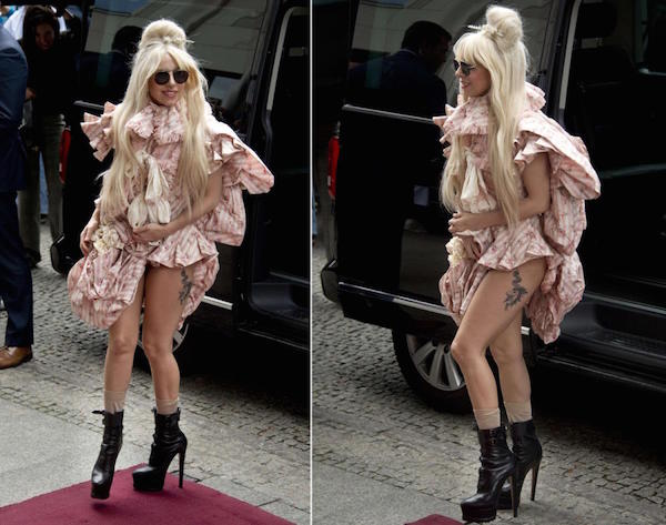 Lady gaga in a cute frock with black shades and showing her leg tattoo
