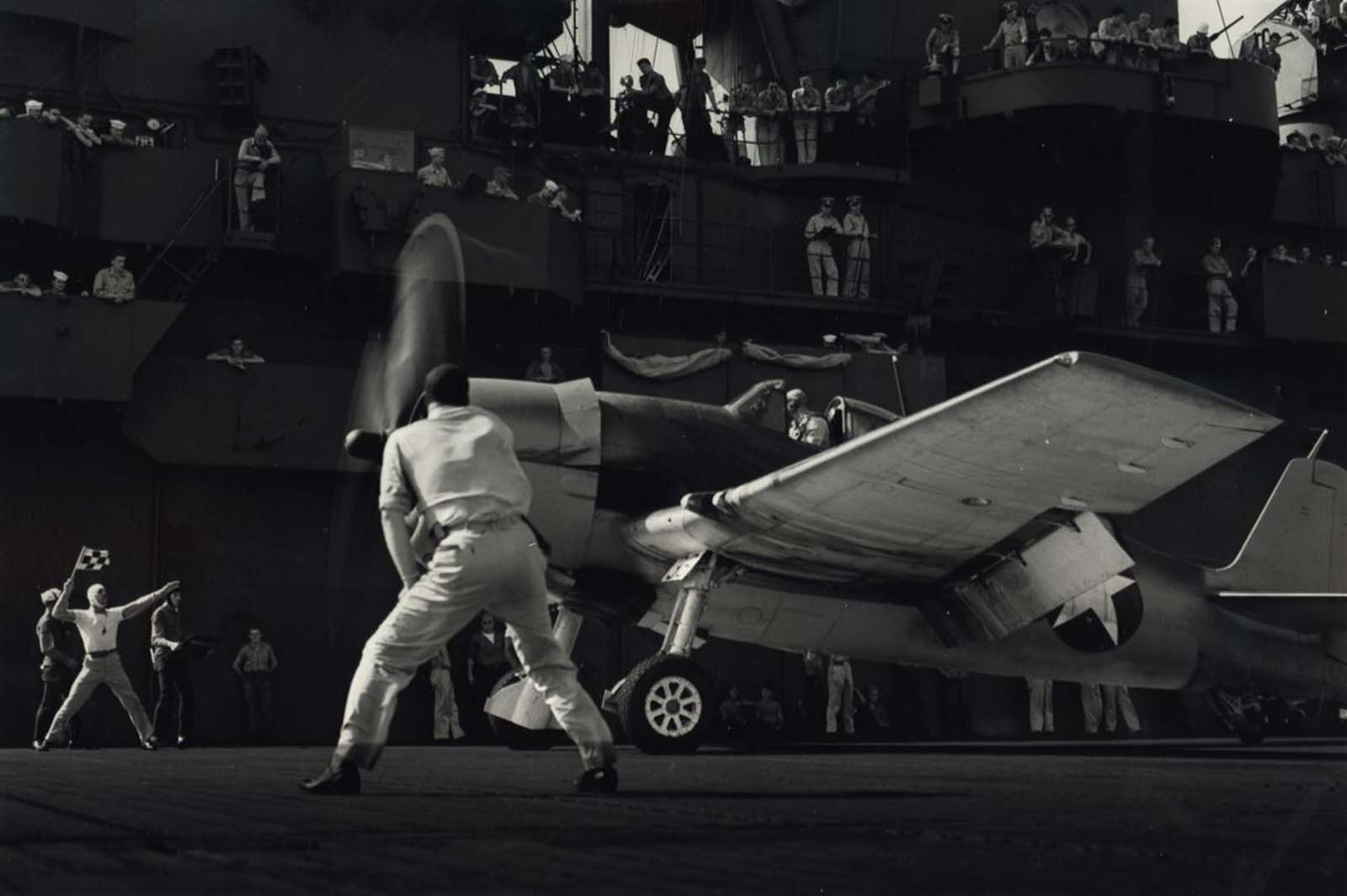 Sailors Watch as Aircraft Takes Off, c. 1943.