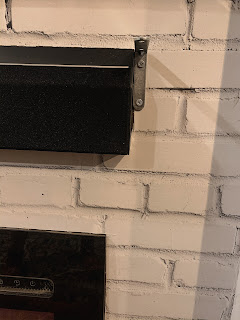 L shaped brackets to support DIY faux mantel