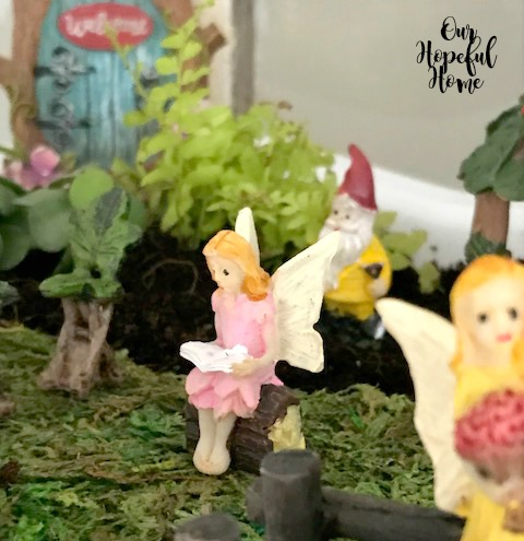 fairy figurine reading book