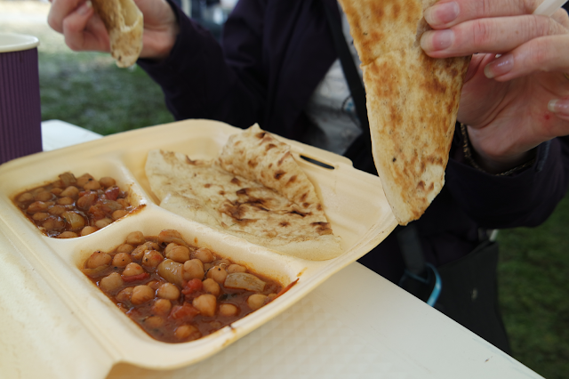a plate of chana masala and naan bread