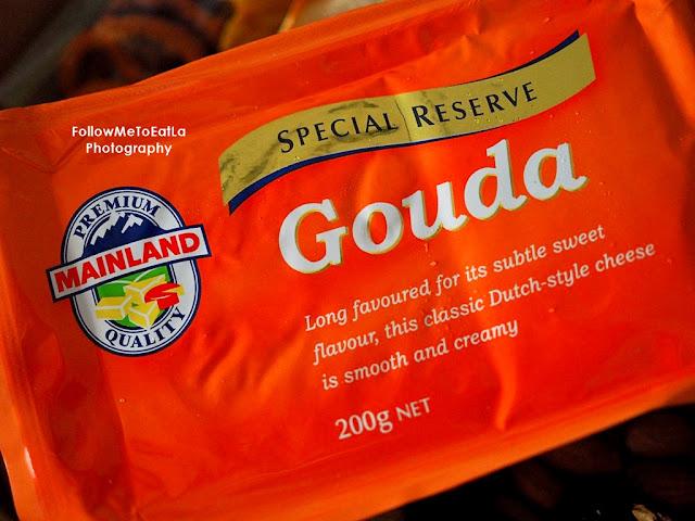 Gouda, which is a Dutch-style semi-soft cheese