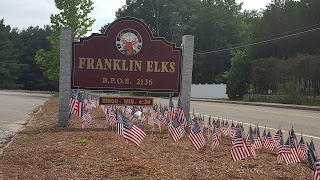 flags placed on the lawn at the Elks Lodge on Ponds St to remember 9/11 victims
