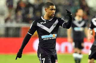 Sport: Tottenham to hijack Arsenal's bid to sign Malcom from Bordeaux
