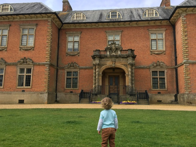 toddler-stood-in-front-of-and-looking-at-Tredegar-House-