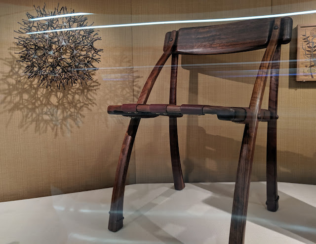 Hammered and soldered copper Sixes by Merry Rink (1976) with shedua and leather Wishbone chair by Arthur E Carpenter (1972)