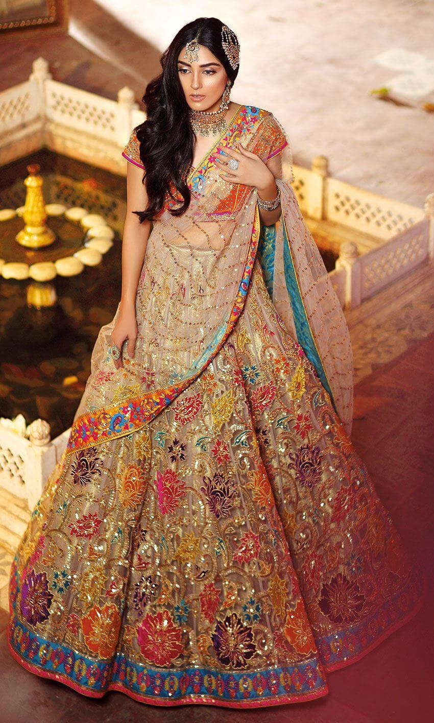 Bridal Mehndi Lehenga Choli by Nomi Ansari with Gold Embroidery work