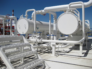 Two large shell and tube heat exchangers at industrial site