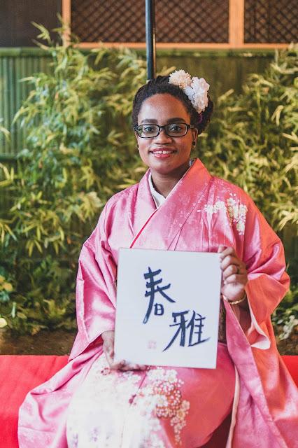 girl holding japanese calligraphy