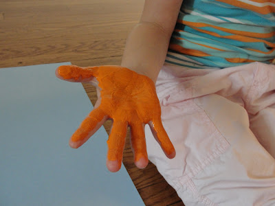 child's hand with paint