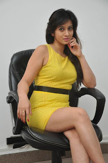 Actress Harshika Poonacha Stills in Yellow Short Dress at Appudala Ippudila Movie Promotions  0035