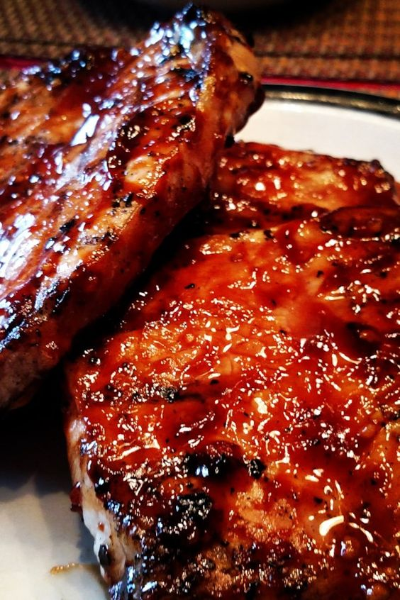"World's Best Honey Garlic Pork Chops | ""How do you turn plain ol pork chops into something SPECIAL on a Sunday afternoon? You make THIS!! MY OH MY!"" #allrecipes #grilling #grillingrecipes #allrecipes"