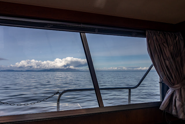 Photo of the view of Scotland from the saloon window while we were at anchor on the Solway Firth