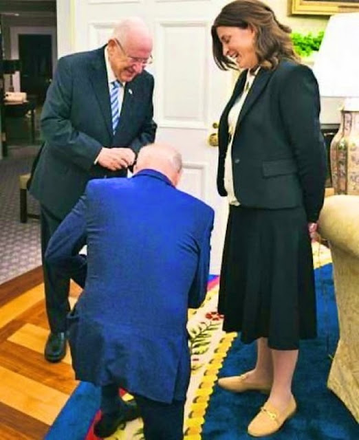 A picture of Biden kneeling in front of a prominent Israeli official causes an uproar