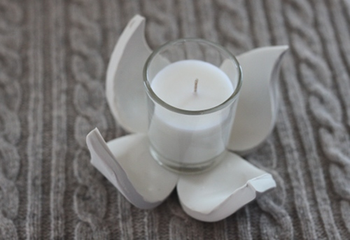 I put a votive candle inside to create a little sculptural candle holder.