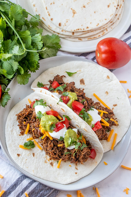 Let the slow cooker do all the work for you with this meal! Perfect for dinner and the leftovers are great for quesadillas, burritos, taco salads and more! This Mexican shredded beef is packed full of flavor from cilantro, cumin, garlic, bell pepper, onion and more!