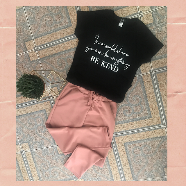 black tshirt with a slogan and pink joggers from Femme Luxe Finery