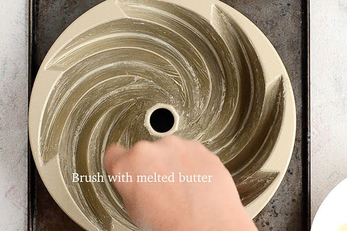 Brush bundt pan with melted butter