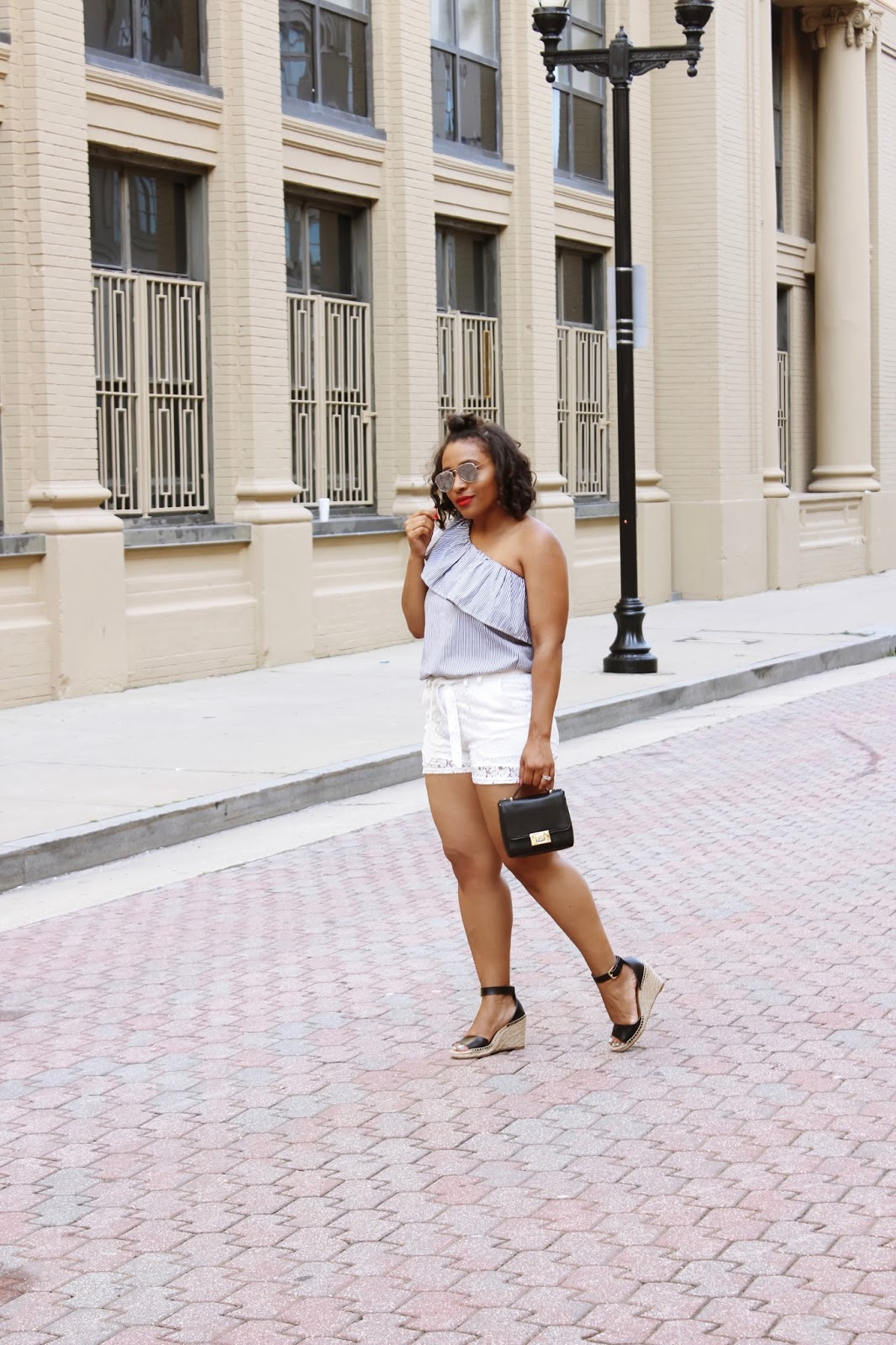 White Lace Shorts, one shoulder trend, summer outfits, white looks, atlantic city board walk, summer outfit ideas, summer shorts, one shoulder top, lace shorts, walking in streets