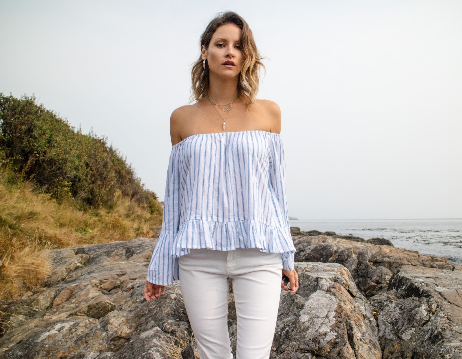 Fashion Blogger, Alison Hutchinson, is wearing a Faithfull the Brand off the shoulder top and Sarah Mulder rose quartz and silver jewelry
