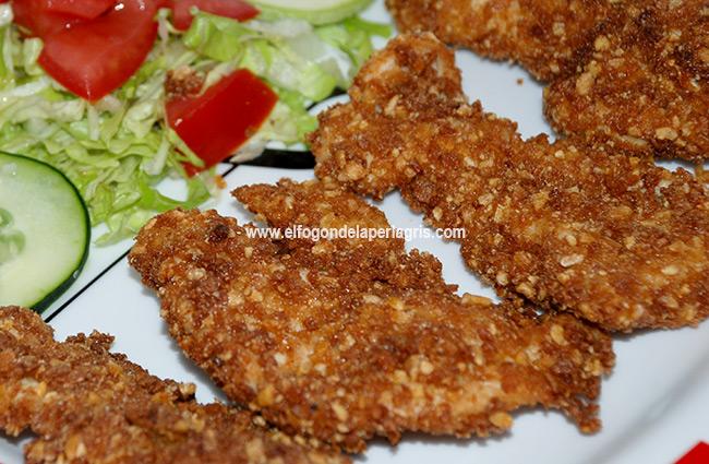 Pollo empanado con kikos