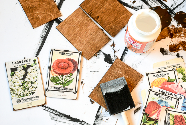 Gluing vintage floral seed prints to wood