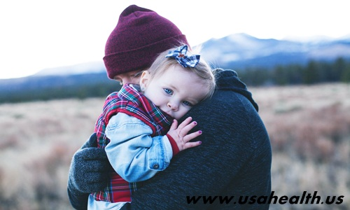 The infant feels reassured when the mother holds it in her arms, but in return it can cause negative effects for the child.