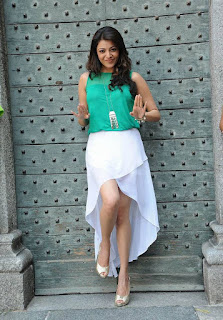 Kajal Aggarwal Rocks her new chick look in White Short Skirt and Sleeveless Green Top