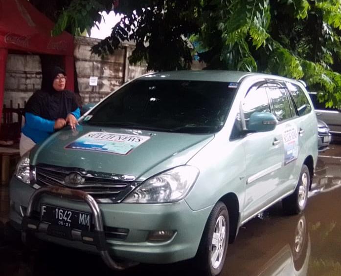 Hujan Disertai Angin Kencang, Mobil Ketua SMSI Kota Tangerang Tertimpa Pohon Yang Lapuk
