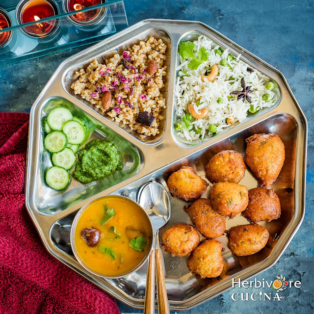 Diwali Thali with Vada, dal, lapsi, rice and salad