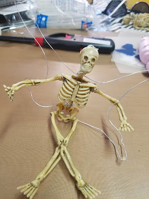 Miniature skeleton with wire wings secured to it's back.
