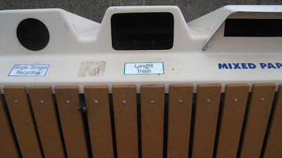 Recycling and trash receptacle labeled Landfill Trash