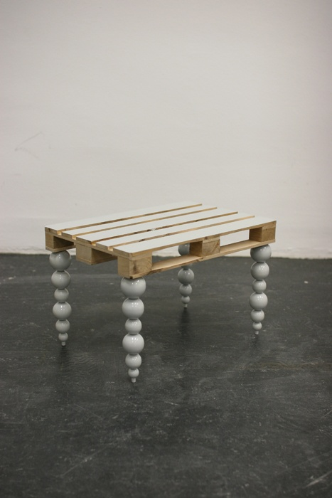 Sometimes all you need to upgrade a pallet into a functional piece of furniture are some unique legs