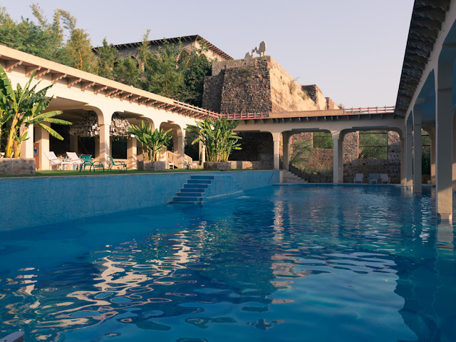blue swimming pool at tijara fort palace alwar rajasthan india
