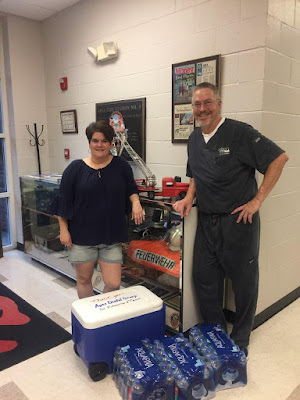 Dr. Kitzmiller and Cindy pose after all water was delivered.