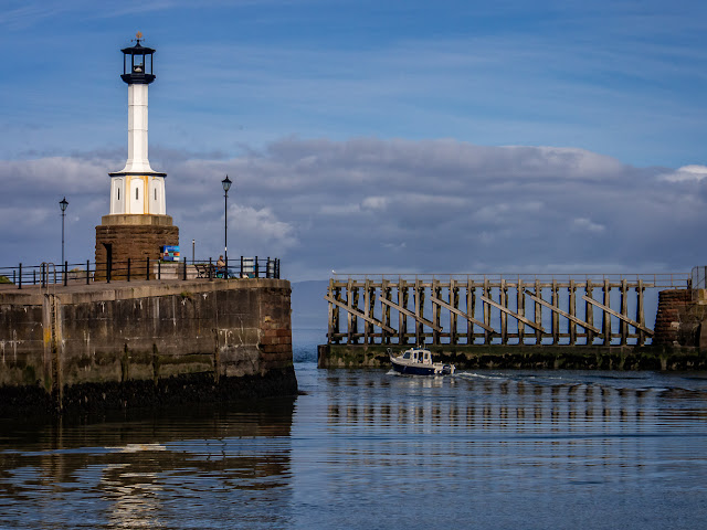 Photo of one of the fishing boats from the marina leaving Maryport Basin