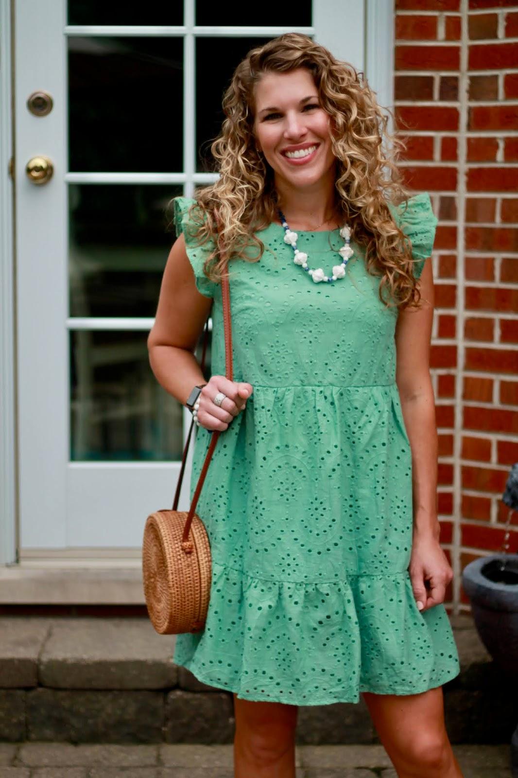 green eyelet dress, gingham heels, round straw bag,
