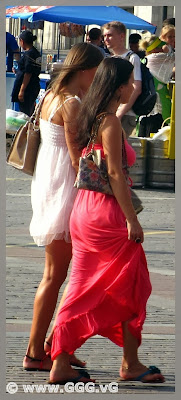 Girls in colorful summer dresses on the street