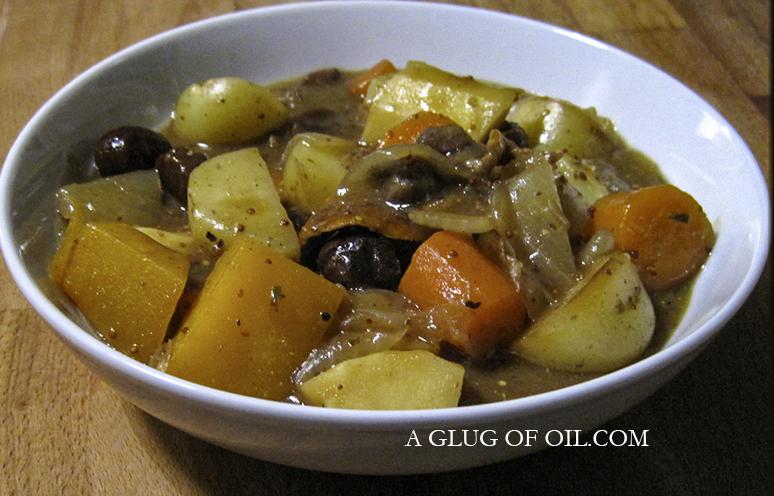 Vegetarian stew in a white bowl