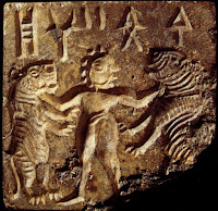 Mohenjo-Daro seal depicting a man grappling with two tigers