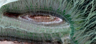 Allegory velociraptor green eye, green iridescence, concentric inner geode, photo of abstract landscapes of deserts of Africa from the air